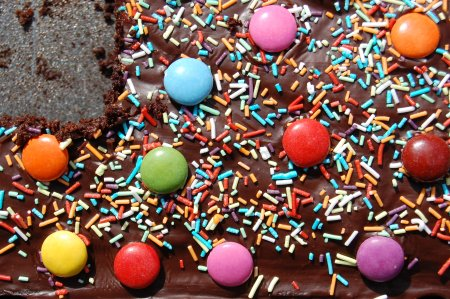 chocolate birthday cake with smarties and sprinkles